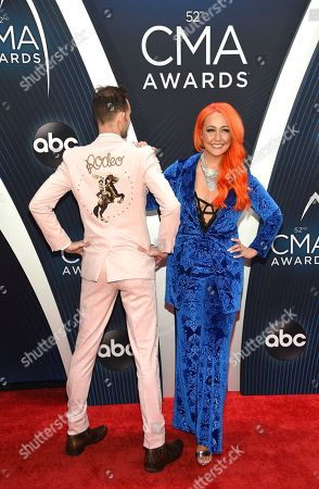 Tyler Cain, Meghan Linsey. Tyler Cain, left, and Meghan Linsey arrive at the 52nd annual CMA Awards at Bridgestone Arena, in Nashville, Tenn