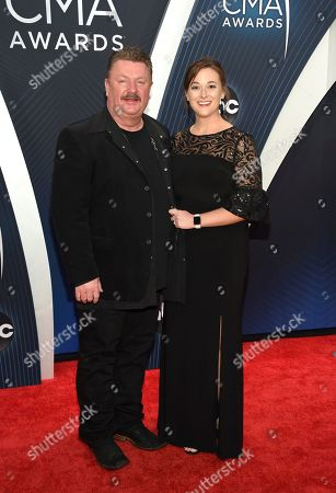 Joe Diffie and Guest. Joe Diffie, left, and Guest arrive at the 52nd annual CMA Awards at Bridgestone Arena, in Nashville, Tenn