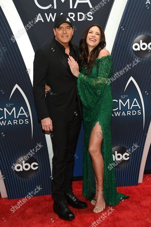 Rodney Atkins, Rose Falcon. Rodney Atkins, left, and Rose Falcon arrive at the 52nd annual CMA Awards at Bridgestone Arena, in Nashville, Tenn