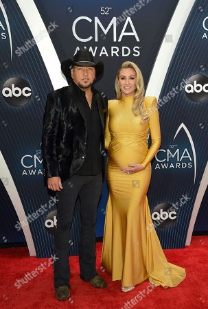 Jason Aldean, Jessica Aldean. Singer Jason Aldean, left, and wife Jessica Aldean arrive at the 52nd annual CMA Awards at Bridgestone Arena, in Nashville, Tenn