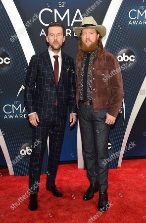 Stock Image of TJ Osborne, John Osborne. TJ Osborne, left, and John Osborne arrive at the 52nd annual CMA Awards at Bridgestone Arena, in Nashville, Tenn