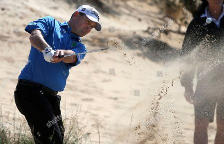 Australia's Greg Chalmers plays from the rough on the first during the Australian Open Golf tournament in Sydney