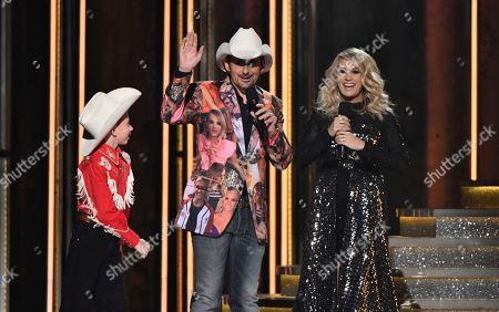 Mason Ramsey, Mason Ramsey, left, 'Floss' dances as hosts Brad Paisley, center, and Carrie Underwood look on
