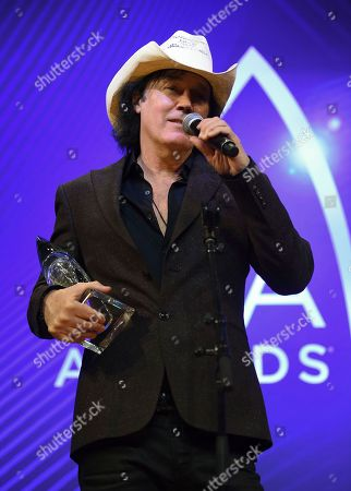 David Lee Murphy poses in the press room with the musical event of the year award at the 52nd annual CMA Awards at Bridgestone Arena, in Nashville, Tenn