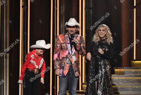 "Mason Ramsey, Brad Paisley, Carrie Underwood. Mason Ramsey, left, ""Floss"" dances as hosts Brad Paisley, center, and Carrie Underwood look on at the 52nd annual CMA Awards at Bridgestone Arena, in Nashville, Tenn"