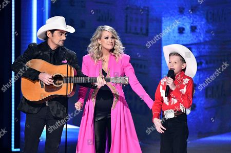 Brad Paisley, Carrie Underwood, Mason Ramsey. Hosts Brad Paisley, from left, Carrie Underwood and Mason Ramsey appear at the 52nd annual CMA Awards at Bridgestone Arena, in Nashville, Tenn