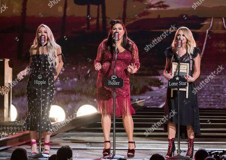 "Ashley Monroe, Angaleena Presley, Miranda Lambert. Ashley Monroe, from left, Angaleena Presley and Miranda Lambert of the Pistol Annies perform ""Got My Name Changed Back"" at the 52nd annual CMA Awards at Bridgestone Arena, in Nashville, Tenn"
