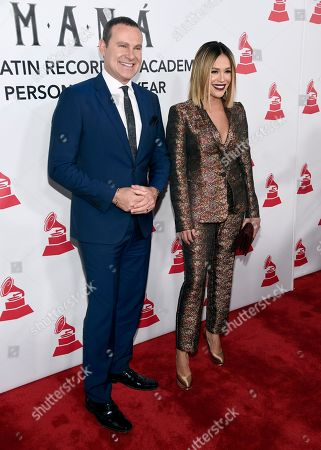 Alan Tacher, Karla Martinez. Alan Tacher, left, and Karla Martinez arrive at the Latin Recording Academy Person of the Year gala honoring Mana at the Mandalay Bay Events Center on