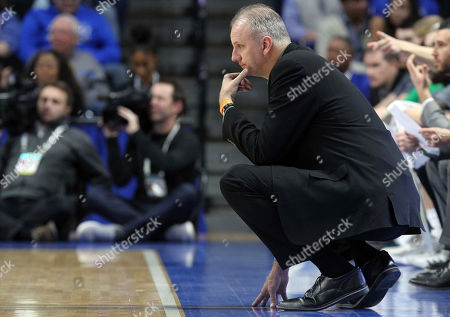 North Dakota head coach Brian Jones looks on during the second half of an NCAA college basketball game against Kentucky in Lexington, Ky., . Kentucky won 96-58
