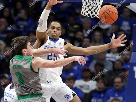 North Dakota's Billy Brown (3) passes around the defense of Kentucky's PJ Washington (25) during the second half of an NCAA college basketball game in Lexington, Ky., . Kentucky won 96-58