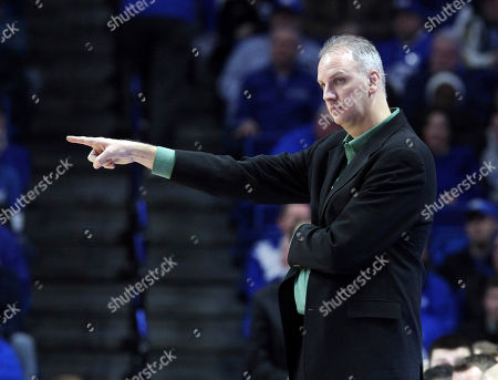 North Dakota head coach Brian Jones directs his team during the second half of an NCAA college basketball game against Kentucky in Lexington, Ky., . Kentucky won 96-58