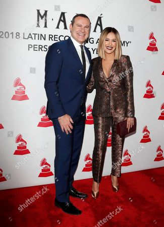 Alan Tacher (L) and Karla Martinez (R) arrive for the 2018 Latin Recording Academy Person of the Year Gala at the Mandalay Bay Convention Center in Las Vegas, Nevada, USA, 14 November 2018. Latin Grammy Awards recognize artistic and/or technical achievement, not sales figures or chart positions, and the winners are determined by the votes of their peers-the qualified voting members of the academy.