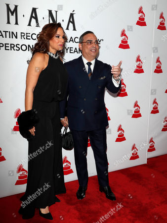 Stock Image of Puerto Rican musician Gilberto Santa Rosa (R) and a guest arrive for the 2018 Latin Recording Academy Person of the Year Gala at the Mandalay Bay Convention Center in Las Vegas, Nevada, USA, 14 November 2018. Latin Grammy Awards recognize artistic and/or technical achievement, not sales figures or chart positions, and the winners are determined by the votes of their peers-the qualified voting members of the academy.