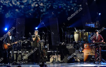 """Pucho, Guillermo Galvan, Jorge Gonzalez. Guillermo Galvan, from left, Pucho and Jorge Gonzalez, of Vetusta Morla, perform """"Cuando Los Angeles Lloran"""" at the Latin Recording Academy Person of the Year gala honoring Mana at the Mandalay Bay Events Center on"""