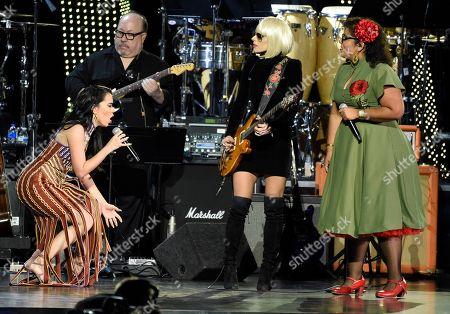 "Beatriz Luengo, Orianthi, La Marisoul. Beatriz Luengo, from left, Orianthi and La Marisoul, of La Santa Cecilia, perform ""Corazon Espinado"" at the Latin Recording Academy Person of the Year gala honoring Mana at the Mandalay Bay Events Center on"