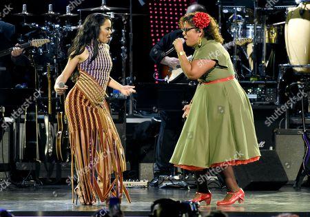 "Beatriz Luengo, La Marisoul. Beatriz Luengo, left, and La Marisoul, of La Santa Cecilia, perform ""Corazon Espinado"" at the Latin Recording Academy Person of the Year gala honoring Mana at the Mandalay Bay Events Center on"