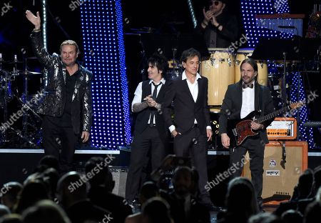 Fher Olvera, Alex Gonzalez, Juan Calleros, Sergio Vallin. Fher Olvera, from left, Alex Gonzalez, Juan Calleros and Sergio Vallin, of Mana, appear on stage after performing at the Latin Recording Academy Person of the Year gala honoring Mana at the Mandalay Bay Events Center on
