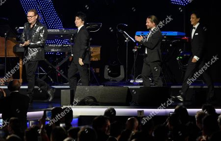 Alex Gonzalez, Fher Olvera, Sergio Vallin, Juan Calleros. Honorees Fher Olvera, from left, Alex Gonzalez, Sergio Vallin and Juan Calleros, of Mana, walk on stage before the start of the Latin Recording Academy Person of the Year gala at the Mandalay Bay Events Center on