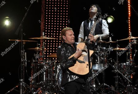 Fher Olvera, Alex Gonzalez. Fher Olvera, in foreground, and Alex Gonzalez, of Mana, perform at the Latin Recording Academy Person of the Year gala honoring Mana at the Mandalay Bay Events Center on
