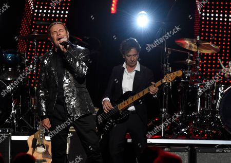 Fher Olvera, Juan Calleros. Fher Olvera, left, and Juan Calleros, of Mana, perform at the Latin Recording Academy Person of the Year gala honoring Mana at the Mandalay Bay Events Center on