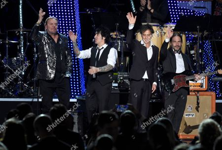 Stock Image of Fher Olvera, Alex Gonzalez, Juan Calleros, Sergio Vallin. Fher Olvera, from left, Alex Gonzalez, Juan Calleros and Sergio Vallin, of Mana, appear on stage after performing at the Latin Recording Academy Person of the Year gala honoring Mana at the Mandalay Bay Events Center on