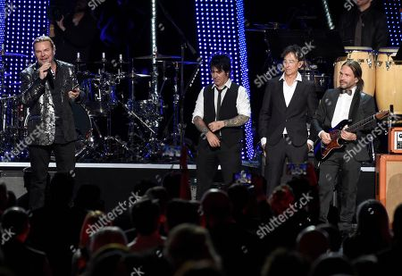 Stock Photo of Fher Olvera, Alex Gonzalez, Juan Calleros, Sergio Vallin. Fher Olvera, from left, Alex Gonzalez, Juan Calleros and Sergio Vallin, of Mana, appear on stage after performing at the Latin Recording Academy Person of the Year gala honoring Mana at the Mandalay Bay Events Center on