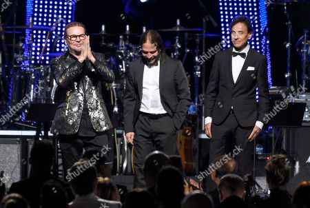 Fher Olvera, Sergio Vallin, Juan Calleros. Honorees Fher Olvera, from left, Sergio Vallin and Juan Calleros, of Mana, appear on stage before the start of the Latin Recording Academy Person of the Year gala at the Mandalay Bay Events Center on