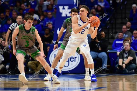 Kentucky Wildcats forward Reid Travis (22) looks to pass the ball around North Dakota Fighting Hawks guard Billy Brown (3) during a NCAA men's college basketball game between the University of North Dakota Fighting Hawks and Kentucky Wildcats at Rupp Arena in Lexington, KY. Kentucky won 96-58
