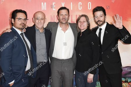 """Michael Pena, Peter Friedlander, Eric Newman, Cindy Holland, Diego Luna. Michael Pena, from left, Peter Friedlander, Eric Newman, Cindy Holland and Diego Luna attend Netflix's """"Narcos: Mexico Season 1"""" premiere event at Regal Cinemas L.A. LIVE, in Los Angeles"""
