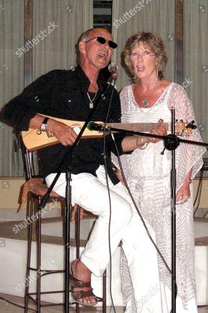 Stock Photo of Noel Janus singing a duet with Sylvan Mason
