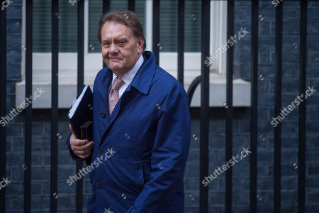 Stock Photo of Britain's Conservative party John Hayes MP arrives in Downing Street, Central London, Britain, 15 November 2018. British Prime Minister Theresa May is facing pressure after six ministers had resigned earlier in the day over her Brexit deal.