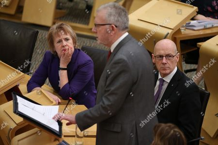 Roseanna Cunningham, Cabinet Secretary for Environment, Climate Change and Land Reform, John Swinney, Deputy First Minister and Cabinet Secretary for Education and Skills, listen to Michael Russell, Cabinet Secretary for Government Business and Constitutional Relations or 'Brexit Minister'