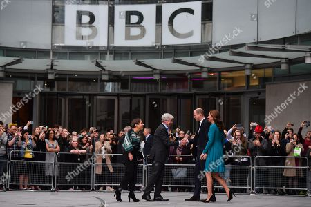 Prince William and Catherine Duchess of Cambridge, (R) are greeted by Director-General of the BBC Tony Hall (2L) and Director of BBC Children's Alice Webb (L) as they visit BBC Broadcasting House