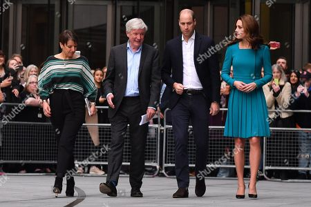 Prince William, (2R) and Catherine Duchess of Cambridge, (R) walk with Director-General of the BBC Tony Hall (2L) and Director of BBC Children's Alice Webb (L) as they visit BBC Broadcasting House