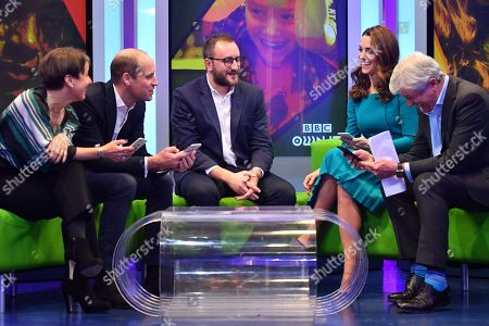 Prince William, (2L) and Catherine Duchess of Cambridge, (2R) sit with Director-General of the BBC Tony Hall (R) and Director of BBC Children's Alice Webb (L) as they try out an App designed to combat online bullying during a visit BBC Broadcasting House