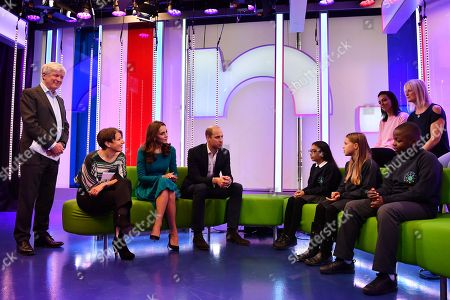 Prince William, (4L) and Catherine Duchess of Cambridge, (3L) with Director-General of the BBC Tony Hall (L) and Director of BBC Children's Alice Webb (2L) talk to children and parents about an App designed to combat online bullying during a visit BBC Broadcasting House