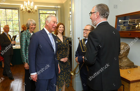 Prince Charles meeting trumpeters and member of the society during a visit to The Royal Society of Musicians of Great Britain
