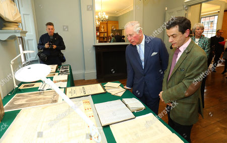 Prince Charles speaking to archivist Colin Coleman during a visit to The Royal Society of Musicians of Great Britain