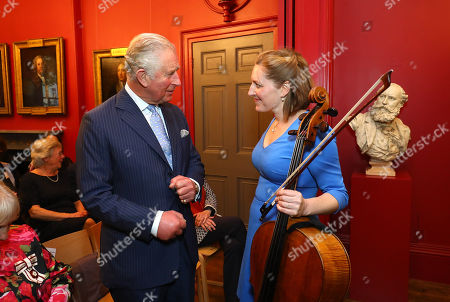 Prince Charles speaking to Cellist Cara Berridge during a visit to The Royal Society of Musicians of Great Britain