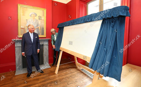 Stock Image of Prince Charles unveils a plaque accompanied by Chairman Fiona Grant during a visit to The Royal Society of Musicians of Great Britain