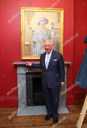 Prince Charles stands by a painting of The Queen Mother during a visit to The Royal Society of Musicians of Great Britain