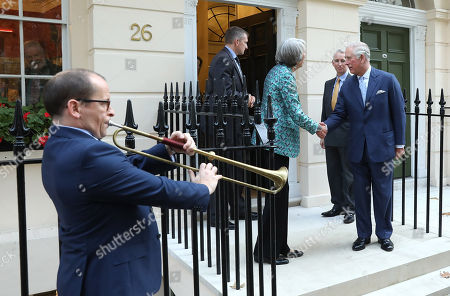 Prince Charles accompanied by Chairman Fiona Grant departs The Royal Society of Musicians of Great Britain after visitng new headquarters
