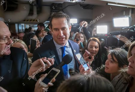 Rep. Seth Moulton D-Mass., is questioned in the basement of the Capitol by reporters on his way to meet with fellow Democrats about his opposition to House Minority Leader Nancy Pelosi, D-Calif., becoming the speaker of the House when the Democrats take the majority in the 116th Congress, in Washington, . A group of 17 Democrats led by Moulton, Rep. Kathleen Rice, D-N.Y., and others, have pledged to vote against Pelosi's return as speaker of the House