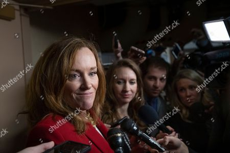 Rep. Kathleen Rice, D-N.Y., talks to reporters about her opposition to House Minority Leader Nancy Pelosi, D-Calif., becoming the speaker of the House when the Democrats take the majority in the 116th Congress, in the basement of the Capitol in Washington, . A group of 17 Democrats led by Rep. Rice, Rep. Seth Moulton D-Mass., and others, have pledged to vote against Pelosi's return as the first female speaker of the House