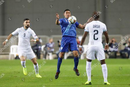Carlos Gallardo  of Guatemala (C) fights for the ball against Eli Dasa of Israel  during a friendly match between Israel and Guatemala in  Netanya,  Israel, 15 November 2018.