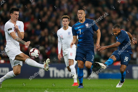 Unites States Julian Green, right, shoots on goal as England's Lewis Dunk, left, tries to block during the international friendly soccer match between England and the United States at Wembley stadium