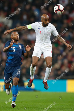 England's Fabian Delph heads the ball before Unites States Julian Green, left, during the international friendly soccer match between England and the United States at Wembley stadium