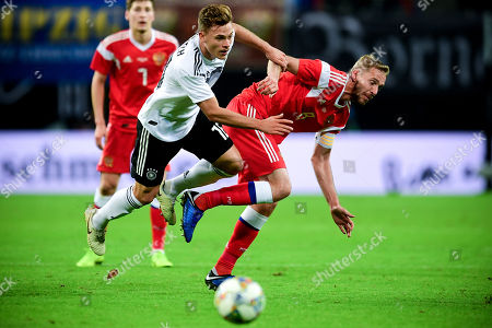 Germany's Joshua Kimmich (L) in action against Russia's Yuri Gazinskiy (R) during the international friendly soccer match between Germany and Russia in Leipzig, Germany, 15 November 2018.