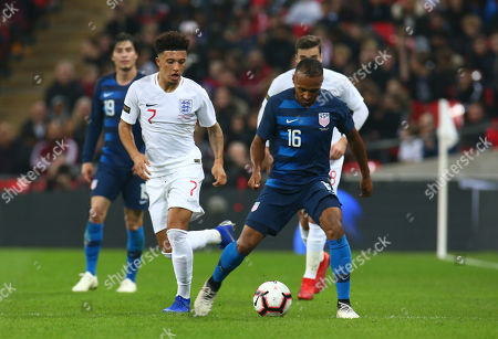 Stock Photo of Julian Green of USA  beats Jadon Sancho of England in action during the friendly soccer match between England and USA at the Wembley Stadium in London, England, 15 November 2018.