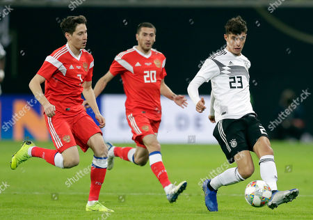 Germany's Kai Havertz, right, and Russia's Daler Kuzyayev, left, challenge for the ball during a friendly soccer match between Germany and Russia in Leipzig, Germany
